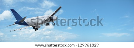 Jet in a sky. Panorama with a lot of useful copy-space. - stock photo