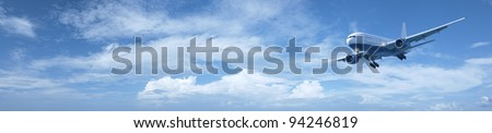 Jet in a sky. Panoramic composition in high resolution. - stock photo