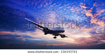 Jet in a sunset sky - stock photo