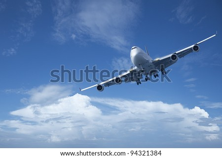 Jet is maneuvering in a blue cloudy sky. High resolution, no interpolation used. - stock photo