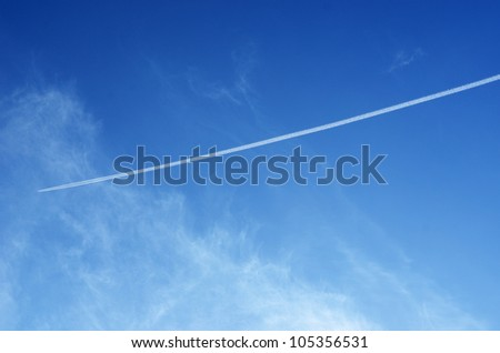 Jet of airplane in the blue sky - stock photo