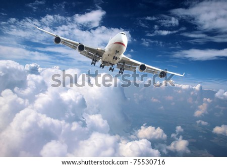 Jet plane above clouds