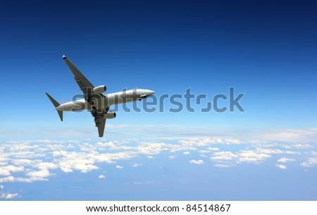 Jet plane above clouds - stock photo