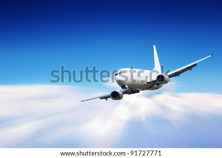 Jet plane flying above clouds - stock photo