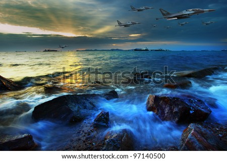 jet plane flying over sea coast in dusky time - stock photo
