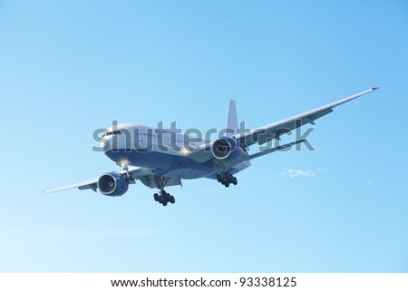 Jet plane in a clear blue sky - stock photo