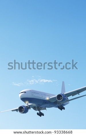 Jet plane in a clear blue sky. Vertical composition. - stock photo