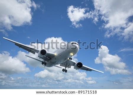Jet plane in flight - stock photo