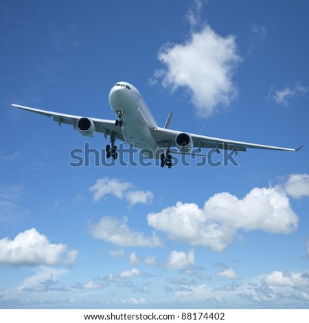 Jet plane in flight. Square composition with some useful copy space. - stock photo