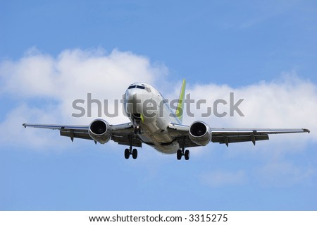 Jet plane is going to land in an airport. - stock photo