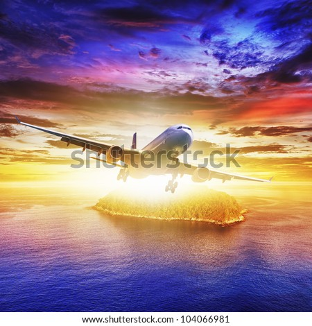 Jet plane over tropical island at sunset time. Square composition. - stock photo