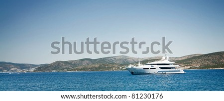 Jet ship in blue bay near Bodrum town. - stock photo
