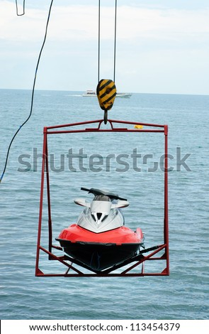 jet ski lift for dry storage   on the sea  background - stock photo
