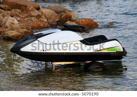 Jet Ski parked in the water - stock photo