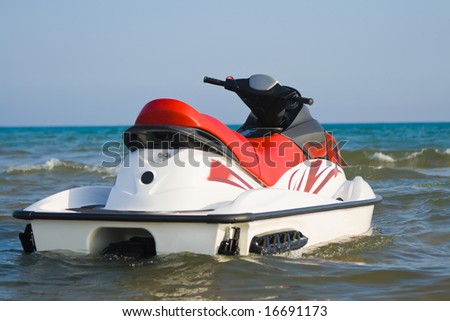 Jet-ski parked on water - stock photo