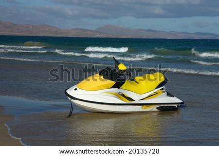 jet-ski parking on the beach - stock photo