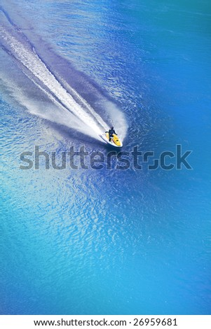 Jet ski racing on a blue water background - stock photo