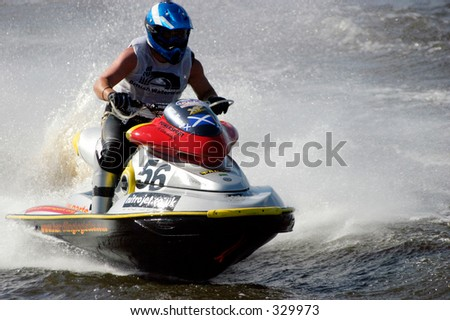 Jet ski stunt action - stock photo