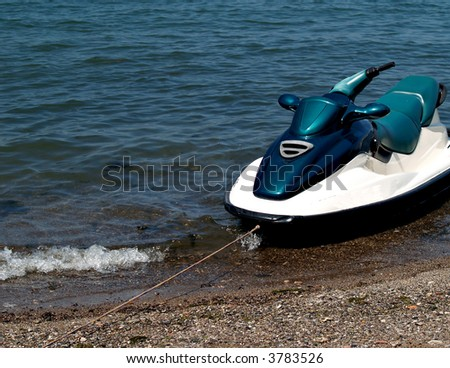 Jet ski tethered in the water on the shore of Lake Erie - stock photo