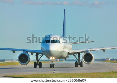 Jet taxiing along the runway in the airport - stock photo