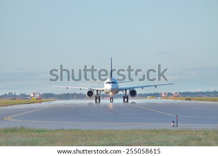 Jet taxiing along the runway in the airport