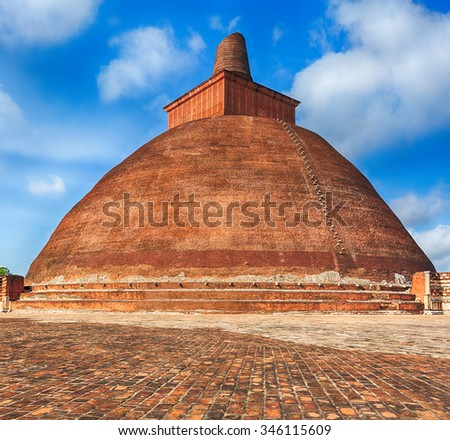 Jetavanaramaya dagoba in the ruins of Jetavana in the sacred world heritage city of Anuradhapura, Sri Lanka - stock photo