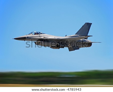 Jetfighter at high speed with motion blur - stock photo