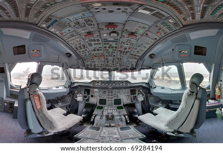 jetliner cockpit wide angle - stock photo