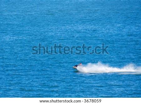 Jetski on lake making a big spray - stock photo