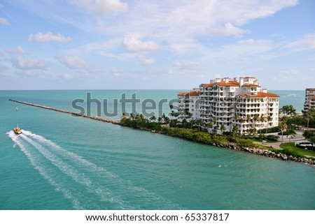 jetty and ocean off luxurious fisher island resort near miami florida - stock photo