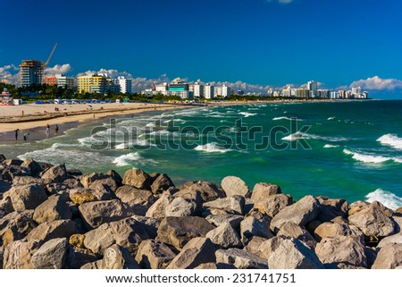 Jetty and view of the beach in Miami Beach, Florida. - stock photo