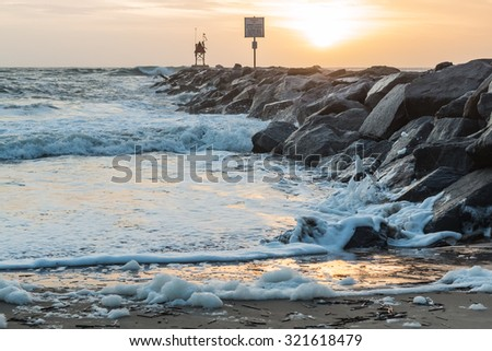 Jetty at Dawn at the Virginia Beach Oceanfront at Rudee Inlet - stock photo