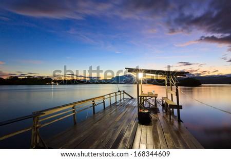 Jetty at sunrise in Sabah, Borneo, Malaysia - stock photo