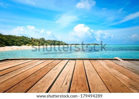 Jetty, beach and jungle - vacation background - stock photo