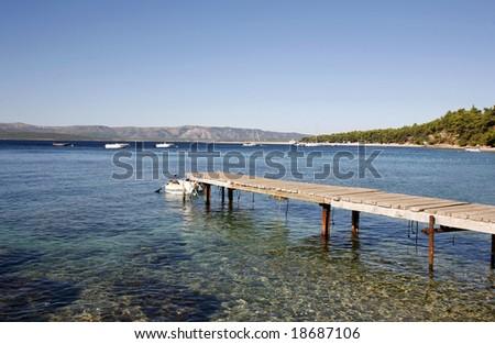 jetty in the mediterranean sea on the island of Brac, Croatia - stock photo