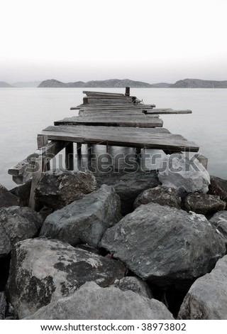 Jetty into a Mountain Lake - stock photo