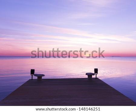Jetty into the Sunrise  - stock photo