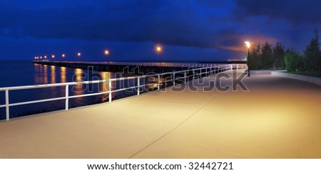 Jetty lights against the deep blue sky - stock photo
