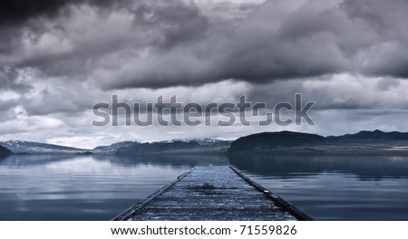 Jetty on a coast - stock photo