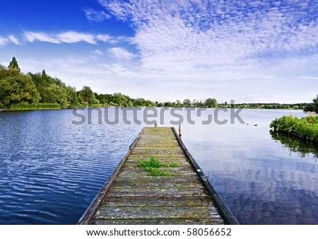 Jetty on a Dutch lake - stock photo