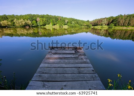 Jetty on a French lake - stock photo
