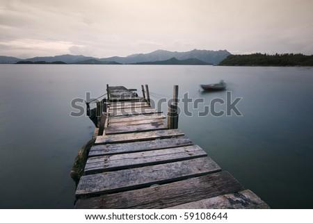 Jetty on a lake - stock photo