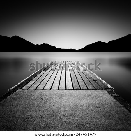 Jetty on a lake in Bavaria, Germany, long time exposure - stock photo