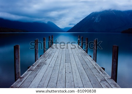 Jetty on a mountain lake - stock photo