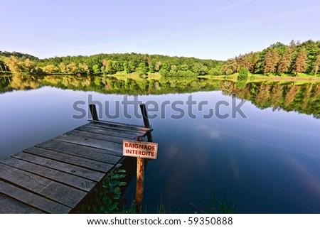 Jetty on lake - stock photo