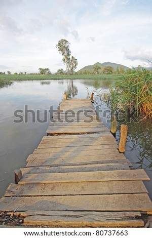 Jetty on lake at day - stock photo
