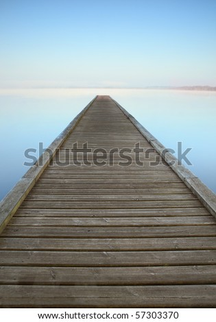 Jetty on misty Azur lake in Aquitaine near Biarritz in France - stock photo