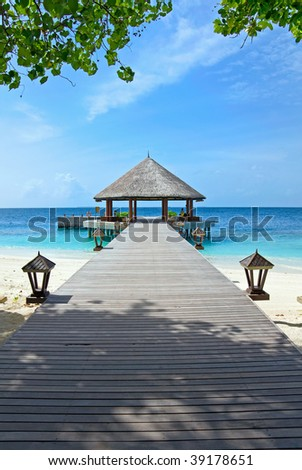 jetty over the ocean on tropical island - stock photo