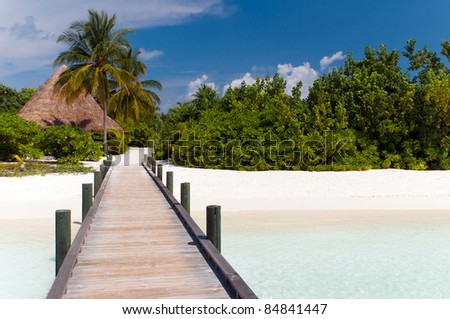 Jetty to a tropical beach