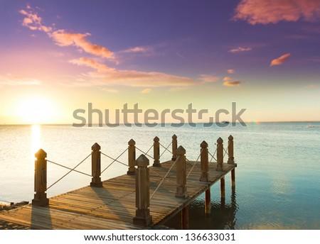 Jetty to sunrise Paradise - stock photo